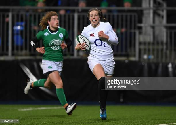 Emily Scarratt of England runs in her team's fourth try during the Women's Six Nations match between Ireland and England at Donnybrook Stadium on...