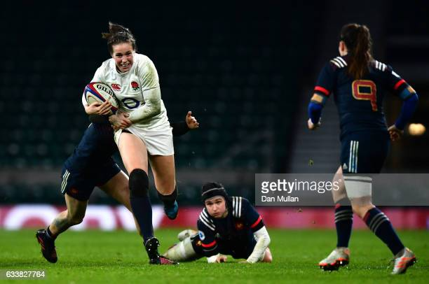 Emily Scarratt of England runs past the French defence during the Women's Six Nations match between England and France at Twickenham Stadium on...