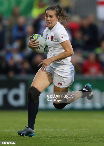Emily Scarratt of England runs with the ball during the Women's Rugby World Cup 2017 Final betwen England and New Zealand at the Kingspan Stadium on...