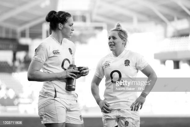 Emily Scarratt of England speaks with Natasha Hunt of England after the Women's Six Nations Tournament match between France and England on February...