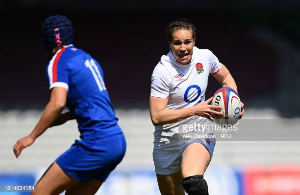 Emily Scarratt of England takes on Cyrielle Banet of France during the Women's Six Nations match between England and France at The Stoop on April 24,...