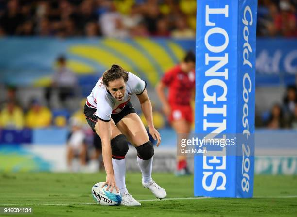 Emily Scarratt of England touches down for a try during the Rugby Sevens Women's Pool B match between England and Wales on day 10 of the Gold Coast...