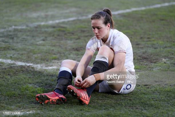 Emily Scarratt of England un ties her boots after her teams victory in the Women's Six Nations Tournament match between France and England on...