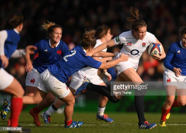 Emily Scarratt of England Women looks to break past the tackle from Agathe Sochat of France Women during the Quilter International match between...