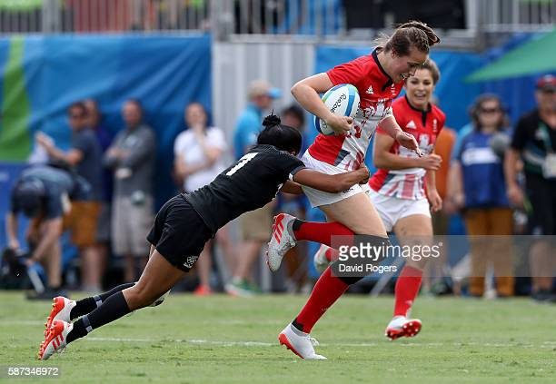 Emily Scarratt of Great Britain breaks through with the ball during the Women's Semi Final 2 Rugby Sevens match between Great Britain and New Zealand...