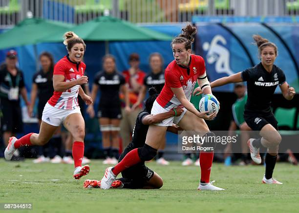 Emily Scarratt of Great Britain throws the ball during the Women's Semi Final 2 Rugby Sevens match between Great Britain and New Zealand on Day 3 of...