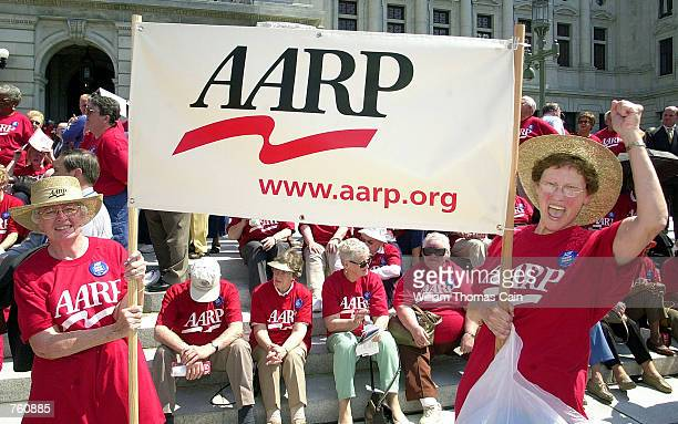 Emily Sconing and Gladys Montgomery rally on the front steps of the State Capitol with more than 1000 AARP members seeking the expansion of the PACE...