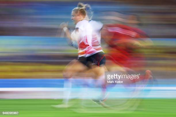 Emily Scott of England breaks away to score a try during the women's Rugby Sevens match between England and Wales on day 10 of the Gold Coast 2018...