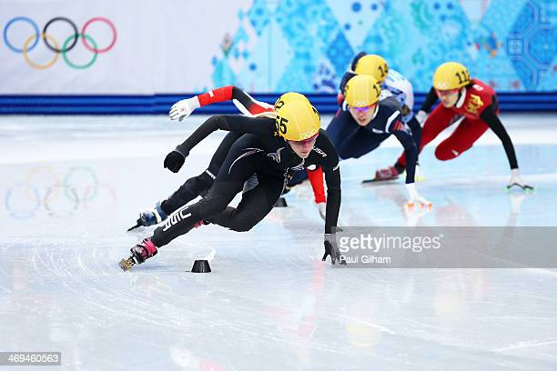 Emily Scott of the United States leads the pack during the Ladies' 1500m Short Track Speed Skating heats on day 8 of the Sochi 2014 Winter Olympics...
