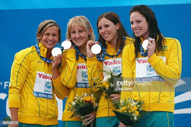 Emily Seebohm Jessicah Schipper Sarah Katsoulis and Lisbeth Trickett of Australia receive the silver medal during the medal ceremony for the Women's...