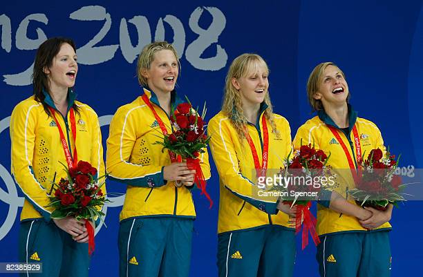 Emily Seebohm, Leisel Jones, Lisbeth Trickett and Jessicah Schipper of Australia celebrate on the podium after receiving their gold medals from the...