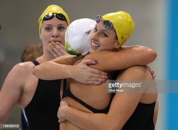 Emily Seebohm Libby Trickett and Brittany Elmslie of Australia celebrate after they finished first in heat two of the Women's 4x100m Freestyle Relay...