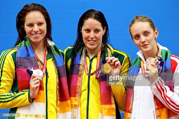 Emily Seebohm of Australia Alicia Coutts of Australia and Francesca Halsall of England pose during the medal ceremony for the Women's 100m Freestyle...