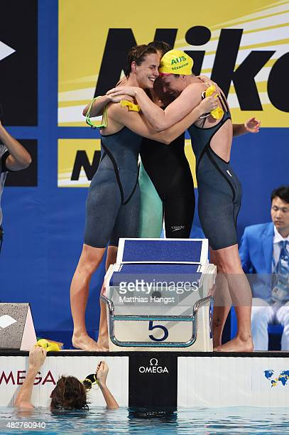 Emily Seebohm of Australia celebreates with her teammates after they set a new course record of 33148 in the Women's 4x100m Freestyle Relay Final on...