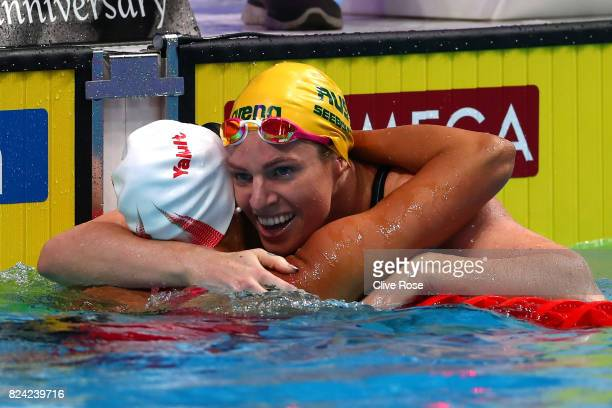 Emily Seebohm of Australia is congratulated by Kylie Jacqueline Masse of Canada after winning the gold medal during the Women's 200m Backstroke final...