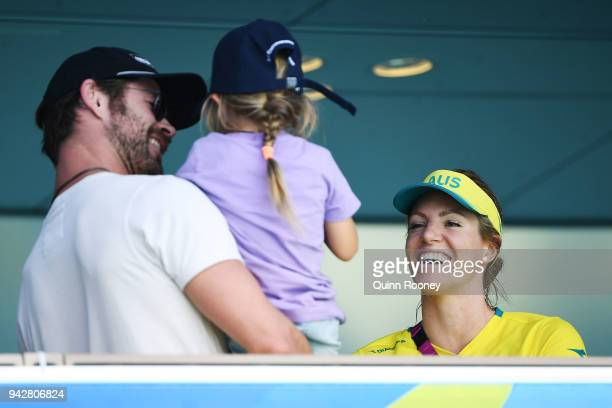 Emily Seebohm of Australia talks to Actor Chris Hemsworth and his daughter India Rose Hemsworth on day three of the Gold Coast 2018 Commonwealth...