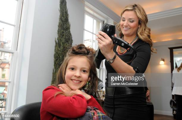 Emily Seiler gets her hair styled by Alexandra Goresh as she is honored by Boston Children's Hospital as Children's Miracle Network Hospitals Child...