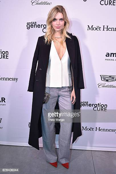 Emily Senko attends the 2016 amfAR GenerationCure Holiday Party at Cadillac House on December 7 2016 in New York City