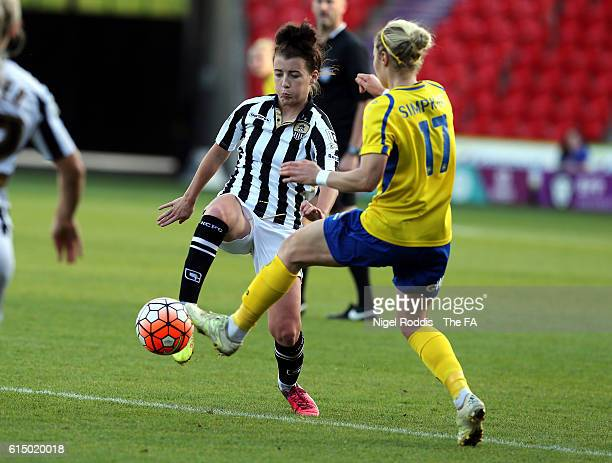 Emily Simpkins of Doncaster Rovers Belles challenges Angharad James of Notts County Ladies FC during the WSL 1 match between Doncaster Rovers Belles...