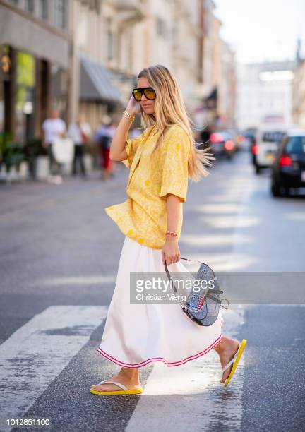 Emily Sindlev wearing Dior saddle bag, yellow button shirt, striped skirt, flip flops seen outside Mykke Hofmann during the Copenhagen Fashion Week...