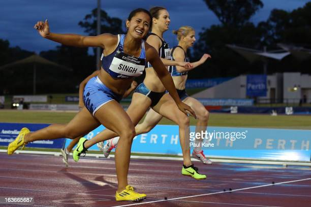 Emily Singh of New South Wales lunges at the line to win the women's u20 200 metre final during day three of the Australian Junior Championships at...