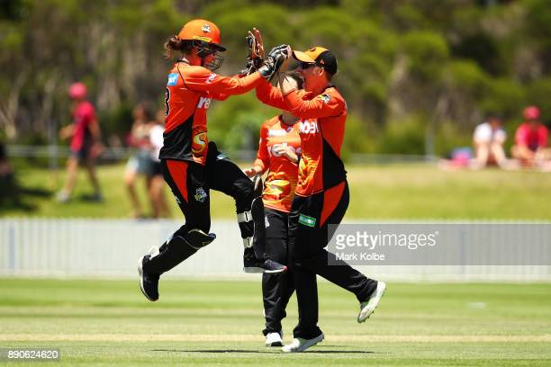 Emily Smith and Elyse Villani of the Scorchers celebrate the run out Dane van Niekerk of the Sixers during the Women's Big Bash League match between...