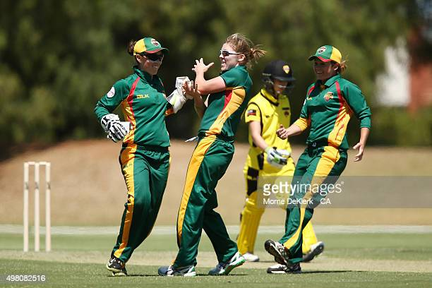 Emily Smith and Heather Knight of the Roar celebrates after getting the wicket of Chloe Piparo of the Fury during the WNCL match between Tasmania and...