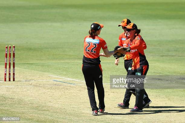Emily Smith and Lauren Ebsary of the Scorchers celebrate the runout of Harmanpreet Kaur of the Thunder during the Women's Big Bash League match...