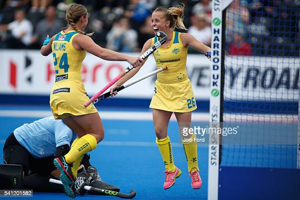 Emily Smith of Australia celebrates with teammate Mariah Williams after she scored the games opening goal during the FIH Women's Hockey Champions...