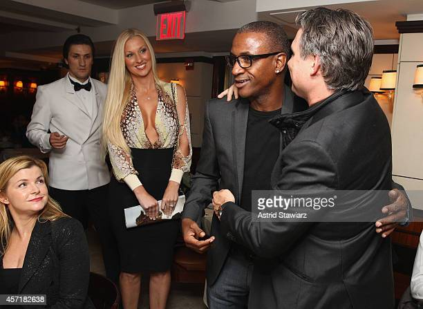 Emily Smith of New York Post and Amanda Moore look on as Comedian Tommy Davidson and Founder of DuJour Media Group Jason Binn greet each other as...