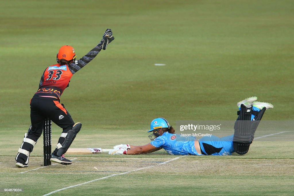 Emily Smith of the Scorchers attempts to run out Suzie Bates of the Strikers during the Women's Big Bash League match between the Perth Scorchers and the Adelaide Strikers at Traeger Park on January 14, 2018 in Alice Springs, Australia.