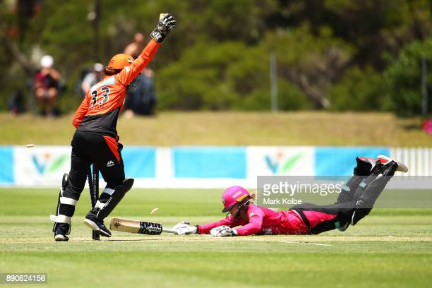 Emily Smith of the Scorchers celebrates running out Dane van Niekerk of the Sixers during the Women's Big Bash League match between the Perth...