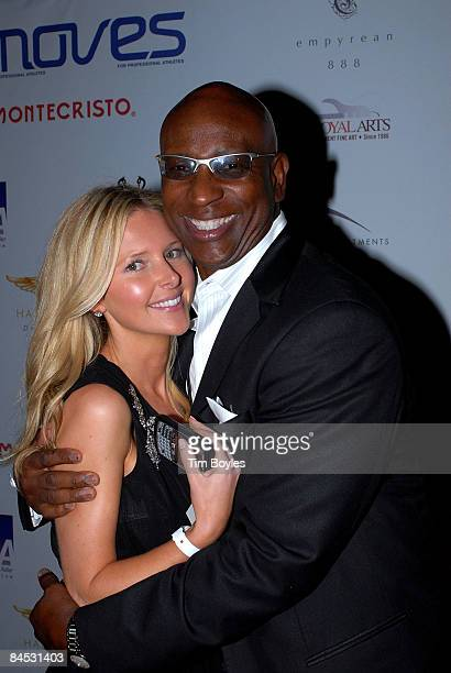 Emily Snider and Former National Football League running back Eric Dickerson arrive for the 2009 Moves Magazine Super Bowl Party at The Venue Club on...