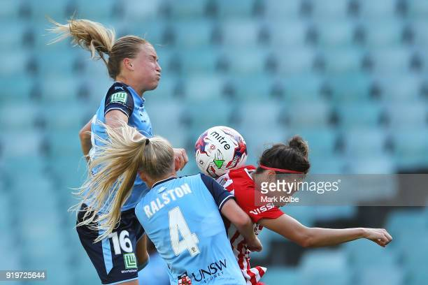 Emily Sonnett and Elizabeth Ralston of Sydney FC compete for the ball with Jodie Taylor of Melbourne City during the WLeague Grand Final match...