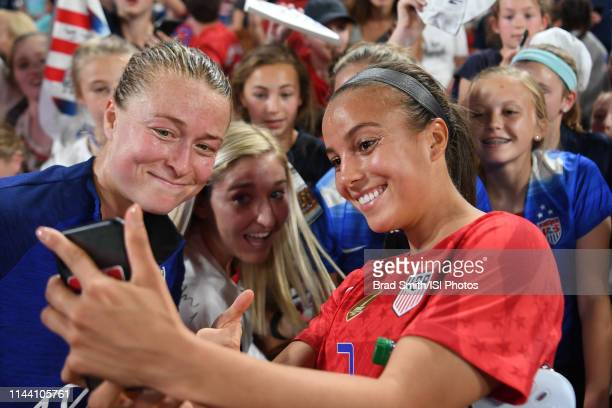 Emily Sonnett and Mallory Pugh of the United States with fans after an international friendly between the women's national teams of the United States...