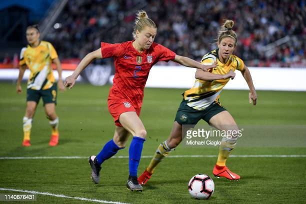 Emily Sonnett of the United States chases a ball down past Elise KellondKnight of Australia at Dick's Sporting Goods Park on April 4 2019 in Commerce...