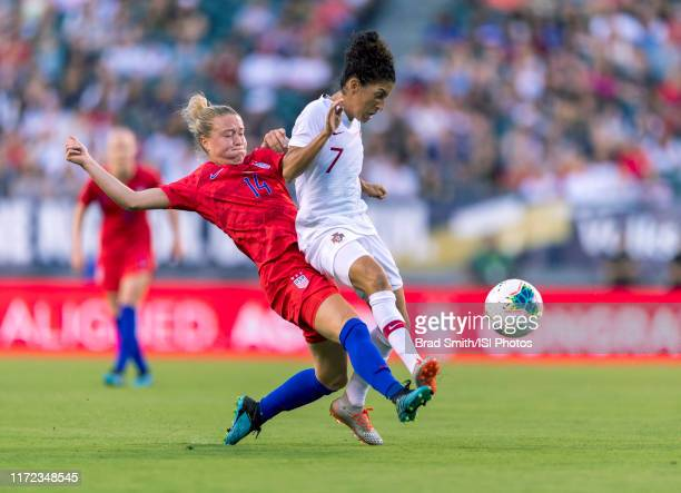 Emily Sonnett of the United States defends Claudia Neto of Portugal during a game between the United States and Portugal at Lincoln Financial Field...