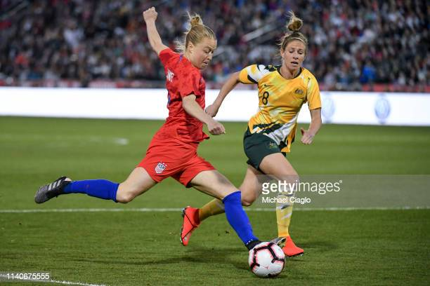 Emily Sonnett of the United States looks for a shot past Elise KellondKnight of Australia at Dick's Sporting Goods Park on April 4 2019 in Commerce...