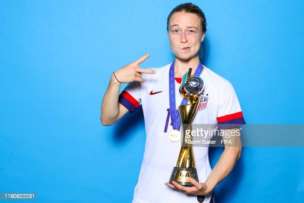 Emily Sonnetts of the USA poses with the Women's World Cup trophy after the 2019 FIFA Women's World Cup France Final match between The United State...