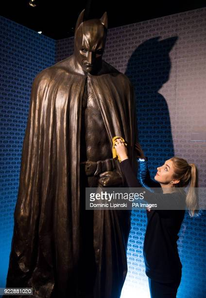 Emily Talbot with a Batman statue from 'The Dark Knight Rises' at the opening of DC Exhibition Dawn of Super Heroes at the O2 in London