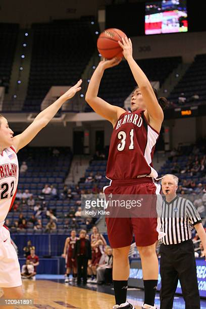 Emily Tay of Harvard with a shot attempt over Maryland's Shay Doron during the NCAA Women's Basketball Tournament first round matchup between the...