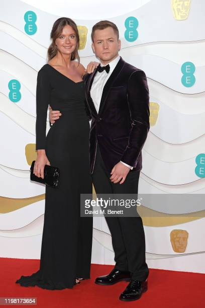 Emily Thomas and Taron Egerton arrive at the EE British Academy Film Awards 2020 at Royal Albert Hall on February 2, 2020 in London, England.