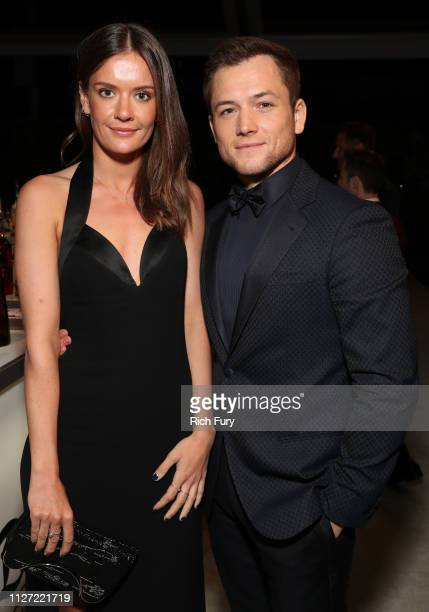 Emily Thomas and Taron Egerton attend the 27th annual Elton John AIDS Foundation Academy Awards Viewing Party sponsored by IMDb and Neuro Drinks...