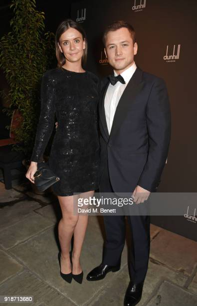 Emily Thomas and Taron Egerton attend the Dunhill GQ preBAFTA filmmakers dinner and party cohosted by Andrew Maag Dylan Jones at Bourdon House on...