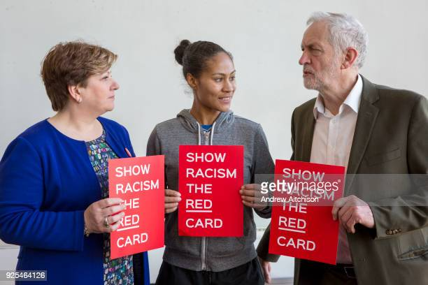 Emily Thornberry MP England footballer Rachel Yankey and Jeremy Corbyn MP show racism the red card at an event at the Emirates stadium Islington...