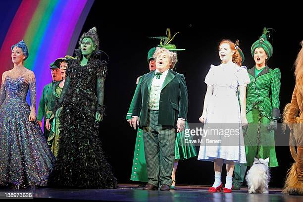 Emily Tierney Marianne Benedict Russell Grant and Sophie Evans bow onstage as Russell Grant joins the West End cast of 'The Wizard of Oz' at London...