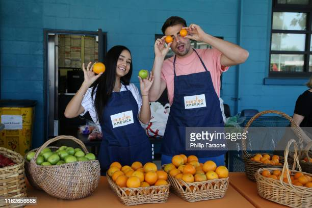 Emily Tosta and Jonathan Bennet attend the Celebrity Friends Of Feeding America volunteer at The Santa Monica Boys and Girls Club to raise awareness...
