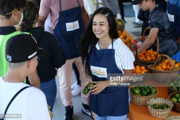 Emily Tosta attends the Celebrity Friends Of Feeding America volunteer at The Santa Monica Boys and Girls Club to raise awareness around summer...