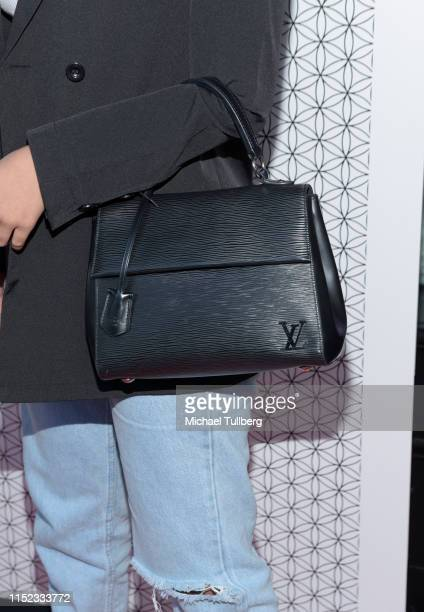 Emily Tosta handbag detail attends a party for Hayley Orrantia's new EP The Way Out at The Harmonist on May 28 2019 in Los Angeles California