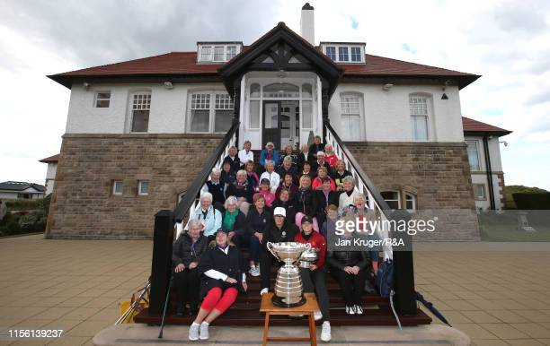 Emily Toy of England and runner up Amelia Garvey pose with members during the final match on day five of the RA Womens Amateur Championship at Royal...